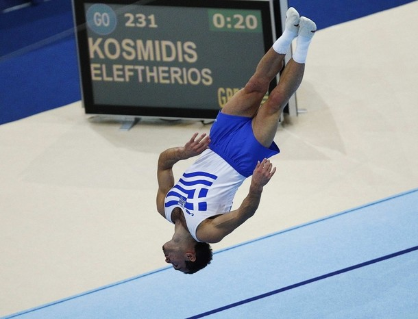 Eleftherios Kosmidis of Greece performs during the men's floor finals at the Artistic Gymnastics World Championships in Rotterdam October 23, 2010. REUTERS/Jerry Lampen (NETHERLANDS - Tags: SPORT GYMNASTICS)