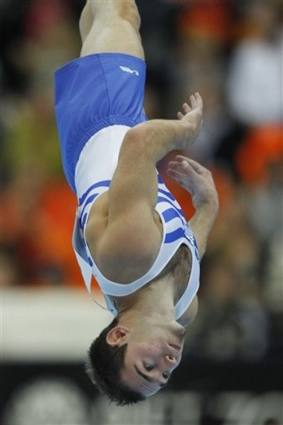 Gold medallist Elefterios Kosmidis of Greece performs during the men's floor final of the World Championships Gymnastics in Rotterdam, Netherlands, Saturday Oct. 23, 2010. (AP Photo/Bas Czerwinski)