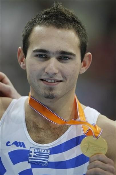 Elefterios Kosmidis of Greece shows his gold medal after winning the men's floor final of the World Championships Gymnastics in Rotterdam, Netherlands, Saturday Oct. 23, 2010. (AP Photo/Bas Czerwinski)